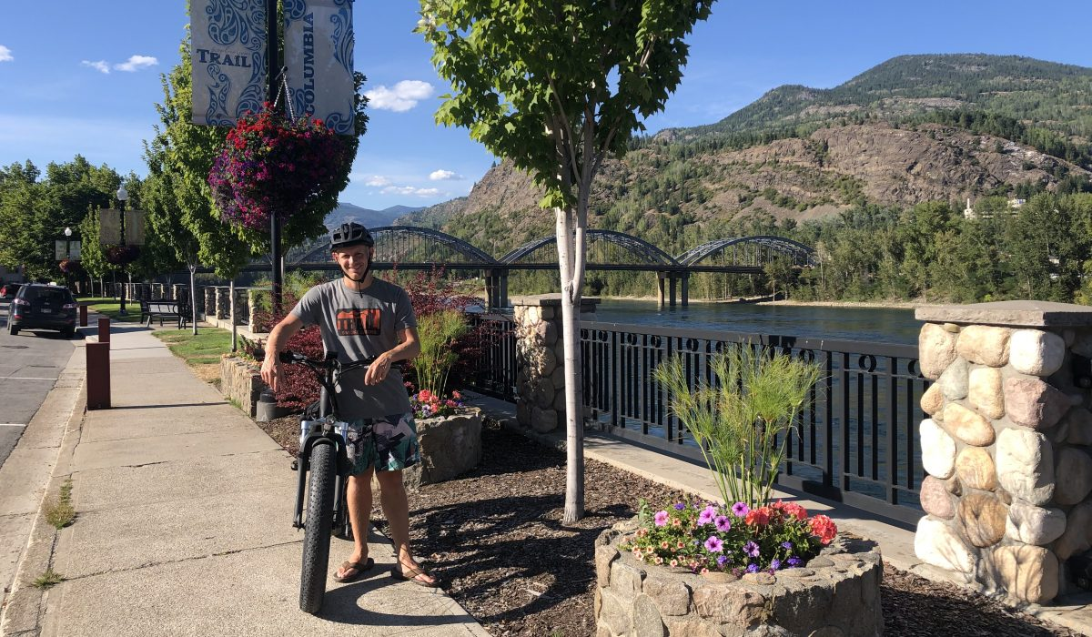 Glen Byle bikes to downtown Trail